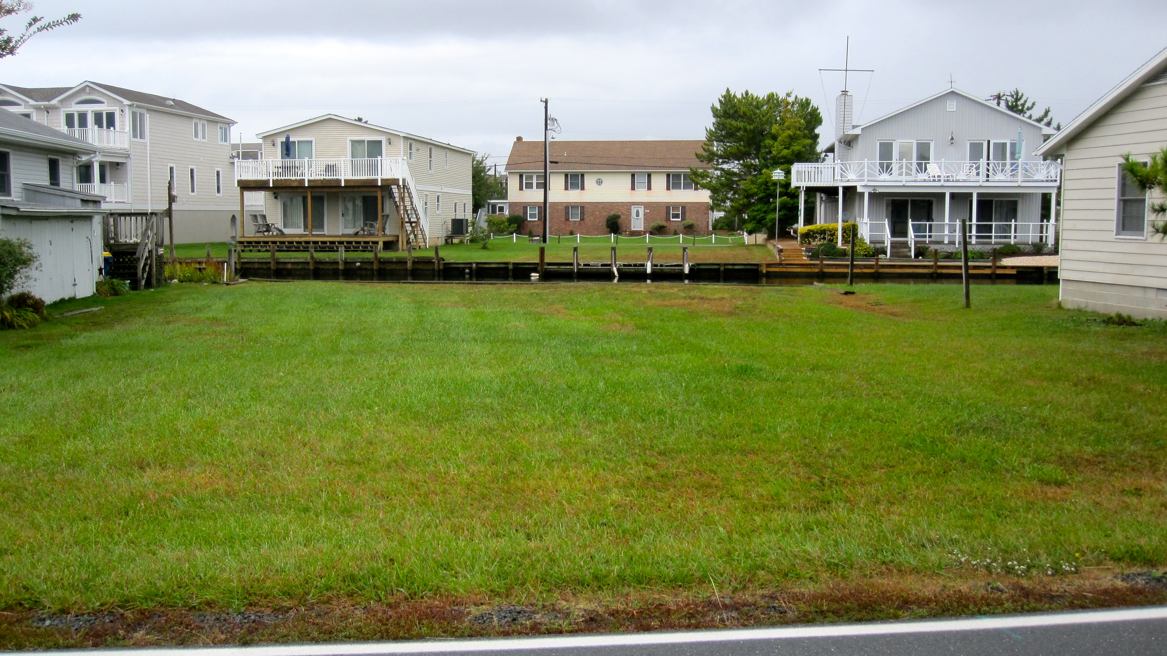 Just Listed: 35 Oyster Bay Drive, Fenwick Island, DE – Fabulous Canal Front Lot!